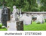 White Gravestone Statue Of...