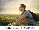 man riding a bicycle in nature... | Shutterstock . vector #272731130