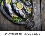 Stock photo mackerels served on silver plate with lemon 272731379