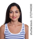 Stock photo passport picture of a smiling turkish woman in a striped shirt 272744030