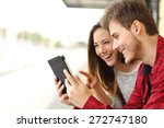 happy couple watching videos or ... | Shutterstock . vector #272747180