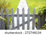 White Picket Fence And A Walkway