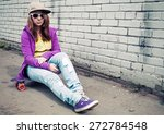 blond teenage girl in jeans and ... | Shutterstock . vector #272784548