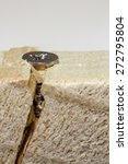 Small photo of Screw cracking wood - Close up screw - Macro screw