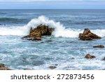Waves Crashing On Rock And...