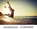 teen girl jumping on the beach...