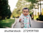 Small photo of Cute african american toddler having fun outdoors in park.