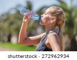 young blonde girl drinking... | Shutterstock . vector #272962934