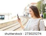 happy traveler using a... | Shutterstock . vector #273025274