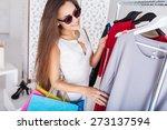 happy woman shopping in... | Shutterstock . vector #273137594