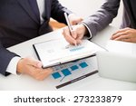 two businessmen looking at... | Shutterstock . vector #273233879