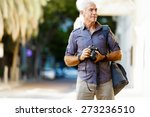 senior man with camera in city | Shutterstock . vector #273236510
