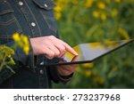 Female Farmer Using Digital...