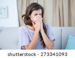 Sick Woman Blowing Her Nose At...
