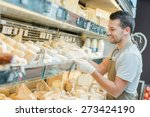 man working in a cheese shop | Shutterstock . vector #273424190