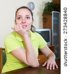 Small photo of Agitated girl deep in thought biting fingers at home