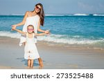 mother and daughter playing on... | Shutterstock . vector #273525488