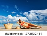 woman in bikini lying on... | Shutterstock . vector #273532454
