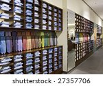 interior of modern shop with shirts and ties - stock photo