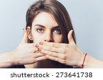 blue eyed brunette girl covers... | Shutterstock . vector #273641738