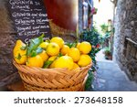 wicker basket full of lemons on ... | Shutterstock . vector #273648158
