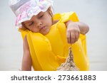 five year girl builds a sand... | Shutterstock . vector #273661883