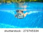 Happy Girl Swims In Pool...