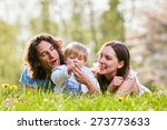 young family together in grass... | Shutterstock . vector #273773633