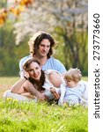 young family together in grass... | Shutterstock . vector #273773660