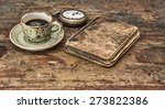 cup of black coffee and antique ... | Shutterstock . vector #273822386