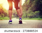 woman runner hold her sports... | Shutterstock . vector #273888524