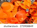 Small photo of Orange accessory for sale at the celebration of King's day - Koningsdag - to celebrate King Willem's birthday.