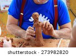 Cuban artist creating a figure with clay - stock photo