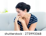 Unhappy Woman Sitting On The...