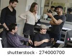 Small photo of Publisher advertising agency owner work with team on a creative project.