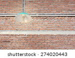 brick wall and lighting decor | Shutterstock . vector #274020443