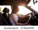 atractive woman driving a car | Shutterstock . vector #274064990