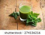 Nettle Leaves And Glass Of...