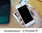 hand holding the smartphone... | Shutterstock . vector #274144679