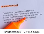 Small photo of above the fold word highlighted on the white paper