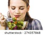 beautiful  young woman eating... | Shutterstock . vector #274357868