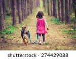 Little Girl Walking With Dog I...