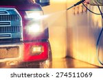 Spring Car Washing. Cleaning Full Size Pickup Truck in the Car Wash Station. - stock photo