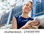 businesswoman with a phone in a ... | Shutterstock . vector #274549799
