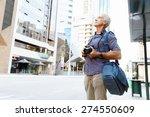 senior man with camera in city | Shutterstock . vector #274550609