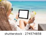 Relaxed Woman Using Tablet...