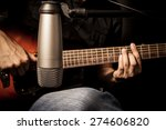 Male Musician Playing Acoustic...