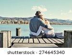 a couple on the wooden jetty at ... | Shutterstock . vector #274645340