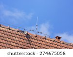 lightning rod wire on the roof... | Shutterstock . vector #274675058