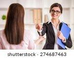 happy realtor woman giving key... | Shutterstock . vector #274687463